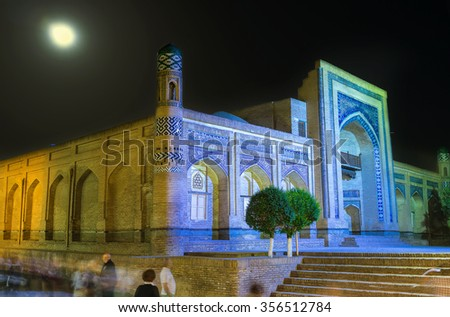 KHIVA, UZBEKISTAN - MAY 3, 2015: The Matniyaz-Divan-beghi Madrassah decorated with islamic patterns looks great in bright evening lights, on May 3 in Khiva.
