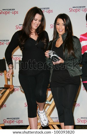 Khloe Kardashian and Kim Kardashian at a press conference to announce a Global Partnership With Kim Kardashian And Kris Jenner, Beverly Wilshire, Beverly Hills, CA. 11-22-10