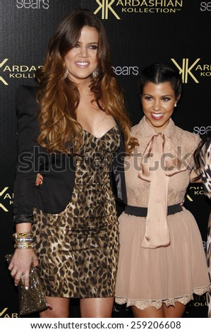 Khloe Kardashian and Kourtney Kardashian at the Kardashian Kollection Launch Party held at the Colony in Los Angeles, California, United States on August 17, 2011.  - stock photo