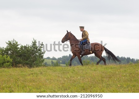 "Khohlovka,Russia - 3 August, 2014.Event "" Great maneurs of World War 2 at Khohlovka"".man in uniform of World War I riding  horse"