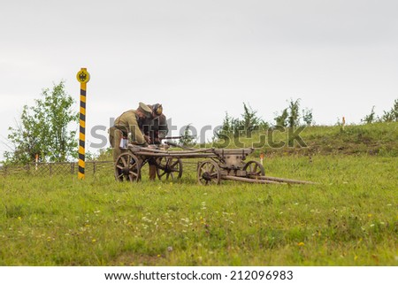 "Khohlovka,Russia - 3 August, 2014.Event "" Great maneurs of World War 2 at Khohlovka"".people in uniform of World War I stood at carts and preparing for reconstruction of fight"