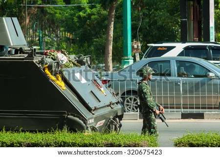 KHON KAEN,THAILAND-MAY 23: Thai people try to take a picture of Thai Army soldier on May 23 2014 at Khon Kaen City Gate Khon Kaen Thailand after Thai Royal Army coup d'etat government