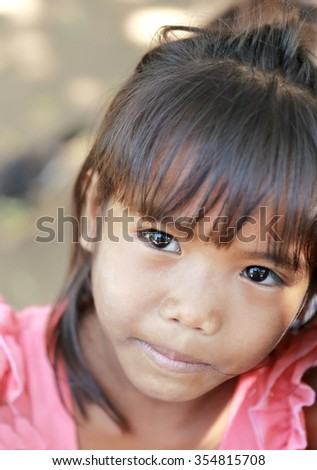 KHON,LAOS-OCTOBER 16, 2015:  Local come to receive visits by tourists out of curiosity on October 16,Khon Laos.