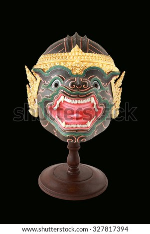 Khon mask on black background, thailand art head of human from Ramayana Story