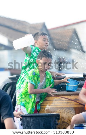 KHONKAEN THAILAND-APRIL 15,2009:Khon Kaen Songkran festival. Thai people and Foreign tourists  enjoy splashing water.Songkran Festival is celebrated in a traditional New Year's Day from April 13 to 15 - stock photo