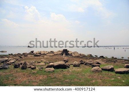 KHONKAEN, THAILAND - APRIL 3,2016:The amount of water the dam Ubolrat greatly reduced. A stump came out sporadically, locals began to make fishing more fish traps have seen from the locals.