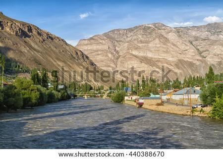 Khorog city, Wakhan coridor. Divided by Panj river (Amu Darya) next to Pamir highway on Marco Polo silk road. Gorno Badakhsan province, Tajikistan, Central Asia - stock photo