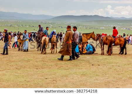 Khui Doloon Khudag, Mongolia - July 12, 2010: Spectators at Nadaam (Mongolia's most important festival whose roots lie in Mongolian warrior traditions) horse race near capital Ulaanbaatar.