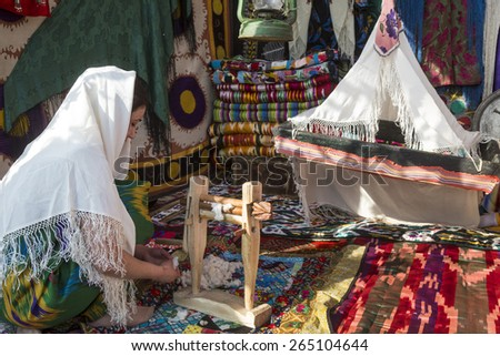 KHUJAND, TAJIKISTAN - MARCH 22, 2015: Reconstruction of the traditional tajik home lifestyle in central park during the celebration of Nowruz holiday in Khujand town, Sughd province, Tajikistan - stock photo