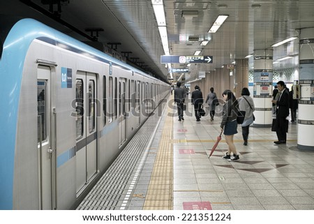 KIBA, TOKYO - APRIL 30, 2014: Platform of Kiba subway station in Koto ward, Tokyo. Kiba station is for Tozai subway line of Tokyo Metro Company. Trains depart every 5 minutes during day time.