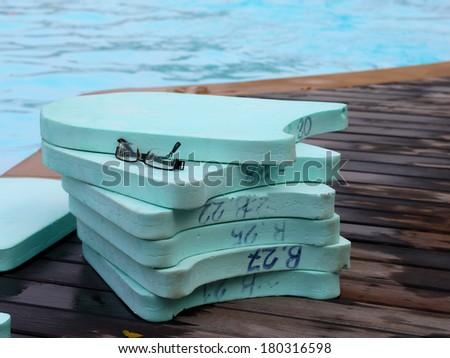 kick board at swimming pool - stock photo