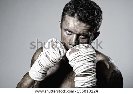 kick-boxer training before fight. Kickboxing or muay thai - stock photo