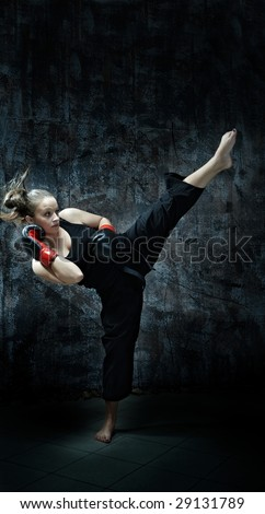 Kick boxing fighting woman wearing boxing gloves