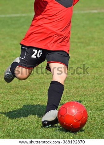 Kick off on a kid soccer match in summer - stock photo