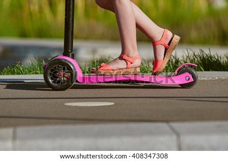 kick scooter with legs - stock photo