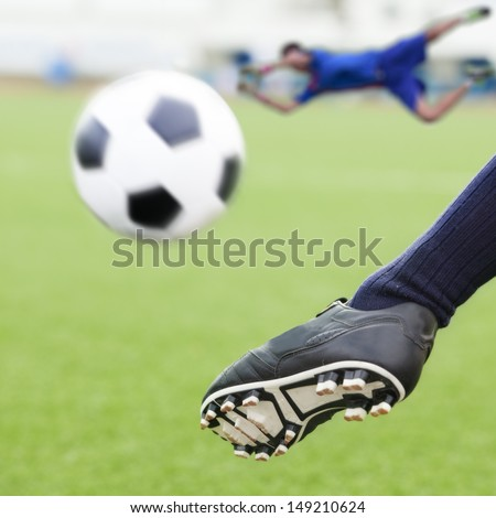 kick soccer ball in goal with loss goalman - stock photo