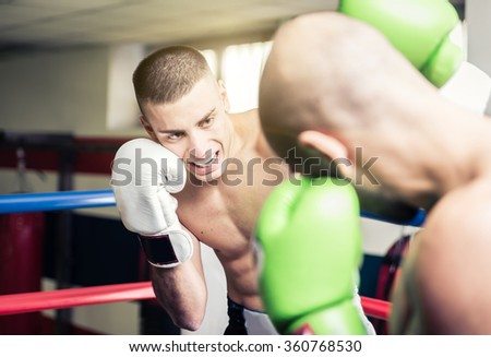 Kickboxers training on the ring. concept about fighting and competition