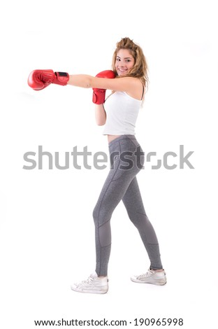 Kickboxing girl exercise in studio. Isolated on a white background. Studio shot