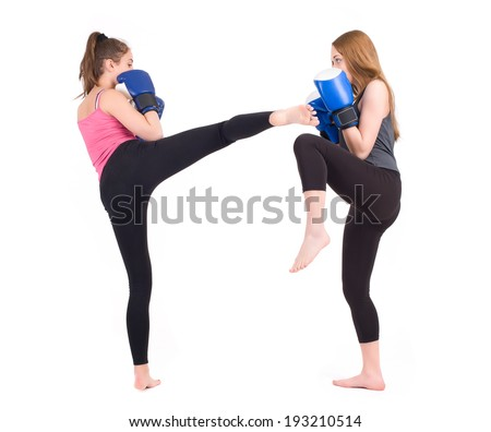 kickboxing girls fight. Isolated on a white background. Studio shot - stock photo