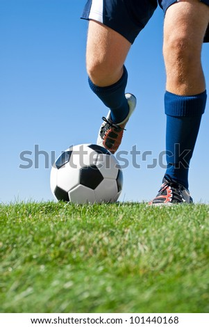 Kicking the Ball low angle - stock photo