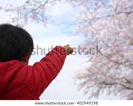 kid and cherry blossom