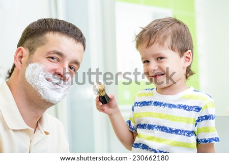 kid boy and father having fun in bathroom at shaving - stock photo