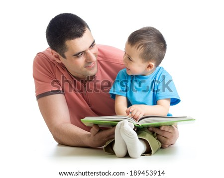 kid boy and his dad read a book - stock photo