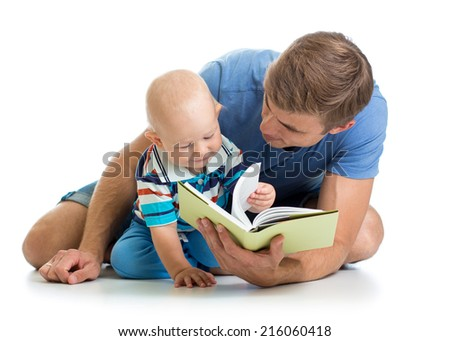 kid boy and his father read a book - stock photo