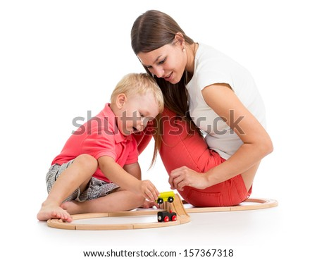 kid boy and his mom play with block toy - stock photo