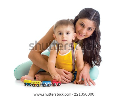 kid boy and his mother play with toy - stock photo