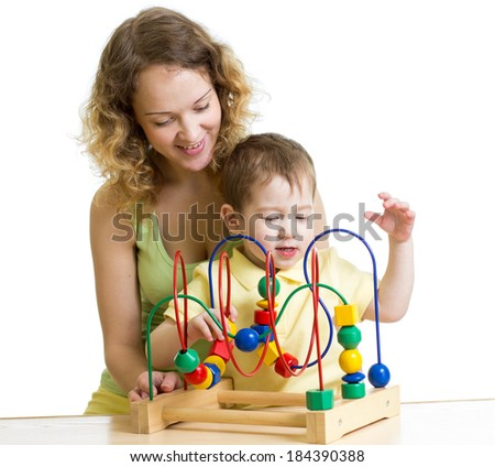 kid boy and mom play with color educational toy - stock photo