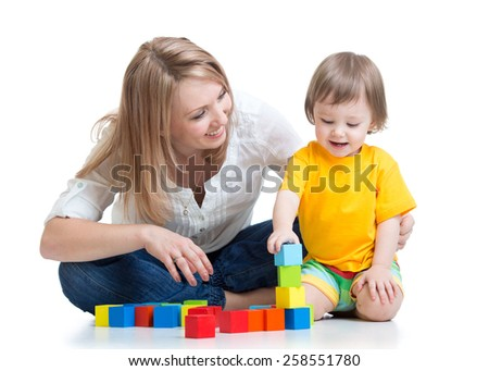 kid boy and mother playing together with construction set toy - stock photo