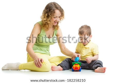 kid boy and mother playing together with toy - stock photo