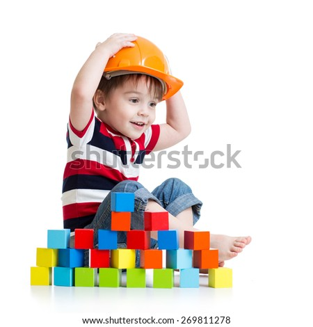 Kid boy as a construction worker in protective helmet on white background - stock photo