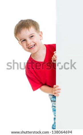 kid boy behind blank advertising banner - stock photo
