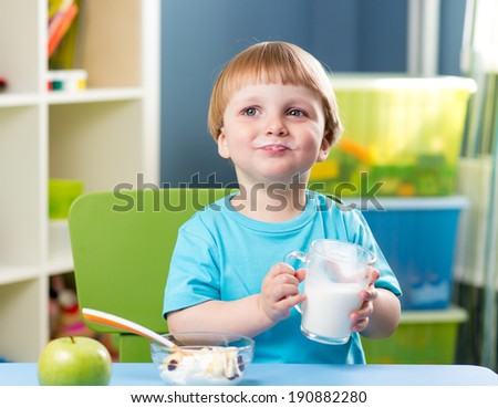kid boy drinking milk - stock photo