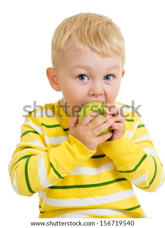 Kid boy eating green apple, isolated on white