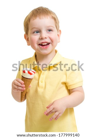 Kid boy eating ice cream isolated on white studio shot - stock photo