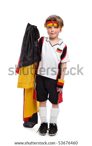 Kid / Boy in complete german soccer outfit is very sad cause the germans have lost the match - stock photo