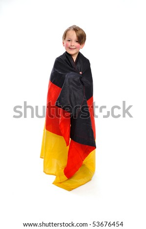 Kid / Boy in complete german soccer outfit wound in a german flag - stock photo