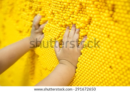 kid boy playing at home or kindergarten focus on hand - stock photo