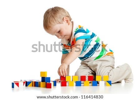 kid boy playing toy blocks  isolated on white background - stock photo