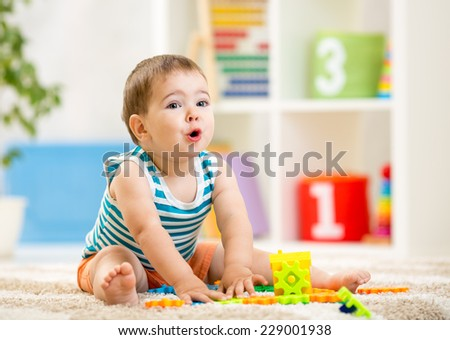 kid boy playing with block toys indoor - stock photo