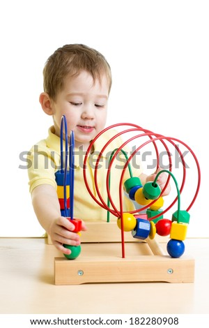 kid boy playing with color educational toy - stock photo