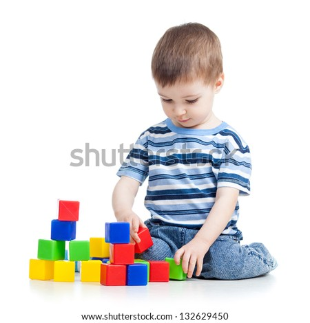 kid boy playing with colorful building blocks or bricks - stock photo