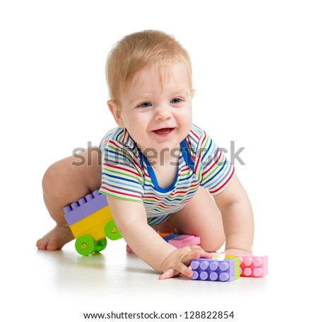 kid boy playing with construction set - stock photo