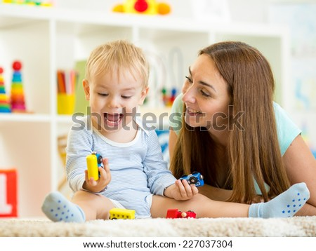 kid boy playing with construction toys indoor - stock photo
