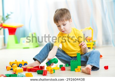 kid boy playing with constructor - stock photo