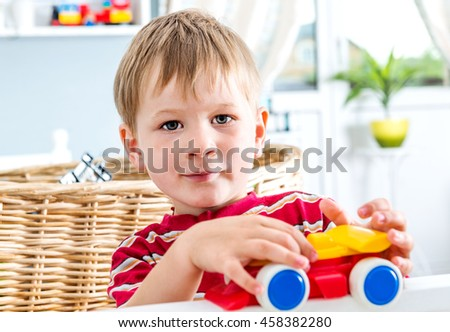 kid boy  playing with toy car