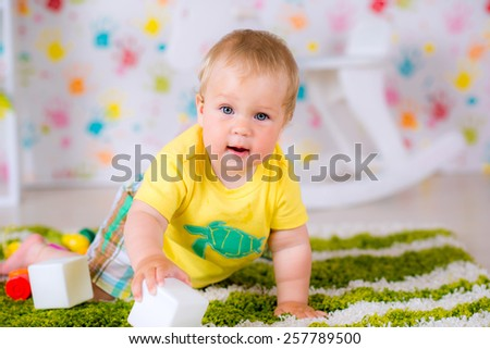 kid boy toddler playing with toy blocks indoors - stock photo